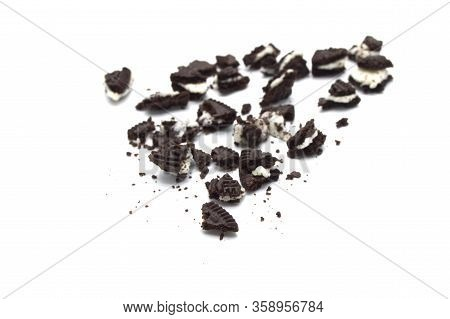 Oreo Biscuits With Crumbs On White Background. It Is A Chocolate Sandwich Cookies With Vanilla Flavo