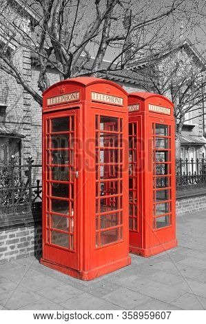 Two Red Telephone Booth On Black And White Background. Red Phone Booth Is One Of The Most Famous Lon