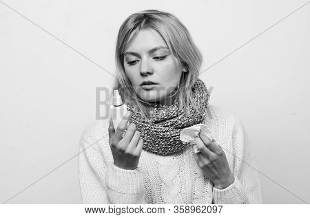 Woman Feels Badly Ill Sneezing. Girl In Scarf Hold Nasal Spray And Tissue. Cold And Flu Remedies. Ru