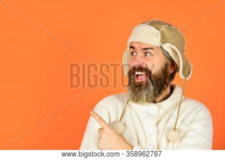 Barber Services. Bearded Man Wear Hat With Ear Flaps. Furry Accessory. Winter Fashion. Warm Hat For