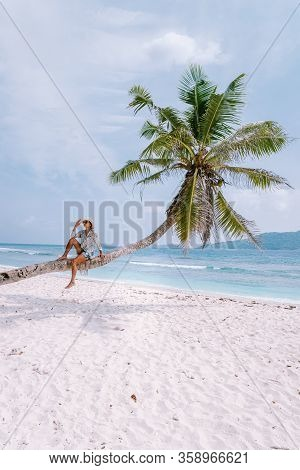 La Digue Seychelles, Sunset On The White Tropical Beach With Palm Tree, Young Woman On Vacation At T