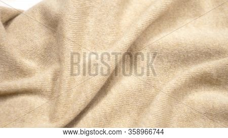 Background Fabric Texture. Folds Of Beige Cashmere Fabric. Closeup.