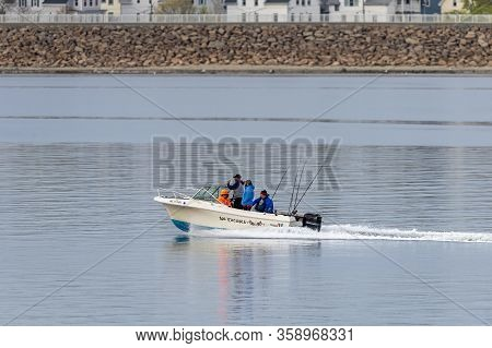 New Bedford, Massachusetts, Usa - May 1, 2019: Powerboat No Excuses With Four Fishermen Cruising Acr
