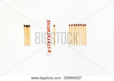 Stay At Home As Stayathome. Concept How To Stop The Coronavirus From Spreading. Matchsticks Burn, On