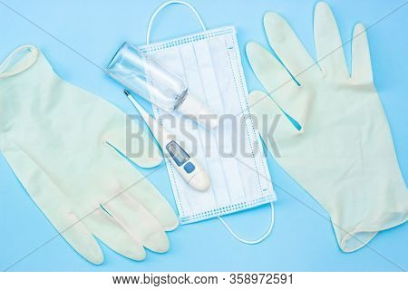 Coronavirus Protection And Treatment: Medical Mask, Hand Antiseptic, Gloves, Thermometer.