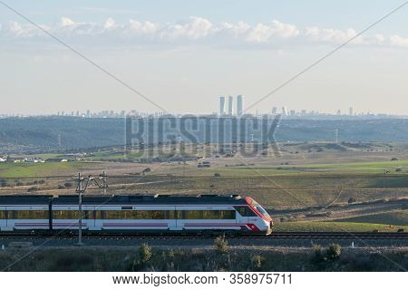 28-12-2018. Madrid, Spain. Madrid Commuter Train. Landscape With Madrid City Skycrapers On The Skyli