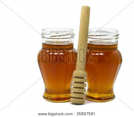 Two jars of honey isolated on white background