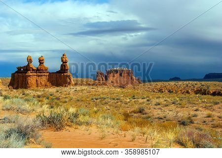 Picturesque huge figures of red-brown sandstone formed as a result of erosion. USA. Scenic Utah state park Goblin Valley. Hoodoo - geological formations. The concept of  ecological and photo tourism