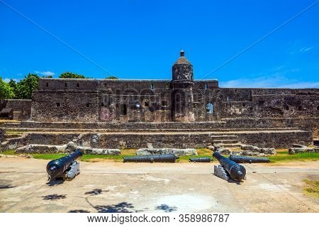 Bastion and loopholes in the thick ancient walls. Fort Jesus -  medieval fortification in Mombasa, Kenya. UNESCO listed Fort as World Heritage Site. The concept of historical, educational tourism