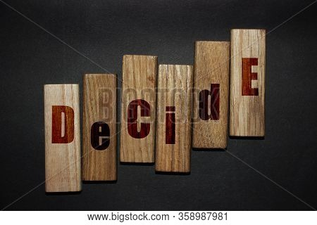 Decide Word Letters Written On Wooden Blocks. Motivational Business Idea Startup Concept