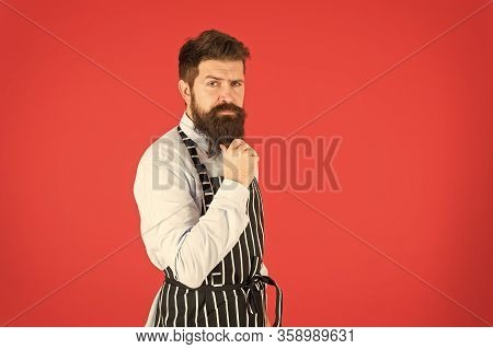 Made Right Choice. Bearded Man In Chef Apron. Brutal Waiter On Kitchen. Mature Man Red Background. S