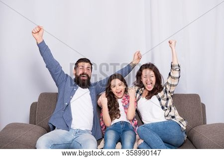 Victory Over Disease. Happy Family Make Victory Gestures At Home. Winners Celebrate Victory Together