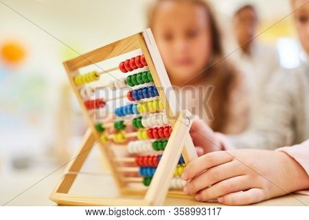 Students learn arithmetic in primary school with their hands on the abacus