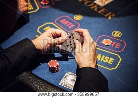 Casino Concept. Las Vegas. Poker Game. Poker Cards. Playing Poker. Cards In Hands. Poker Face.