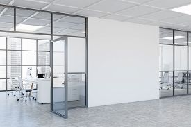 Interior Of Modern Business Center Hall With White And Glass Walls, Concrete Floor, Open Space Offic