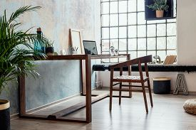 Stylish Interior Design Of Office Space In Loft Apartment With Wooden Desk, Chair, Office Supplies,
