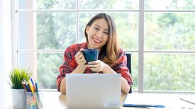 Work From Home, Social Distancing, Asian Women Working Online With Laptop Computer At Home Office, A