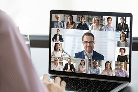 Employee Talk On Webcam Conference With Diverse Colleagues