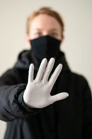 Girl In Protective Gloves Shows A Stop Sign With A Hand. Epidemic. Close-up