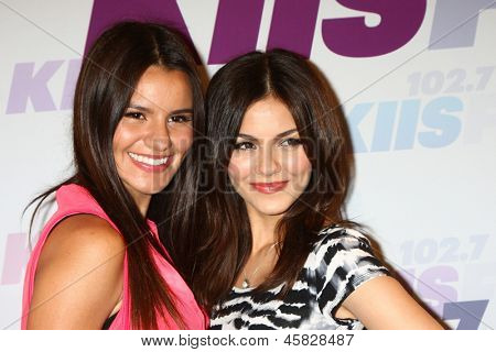 LOS ANGELES - MAY 11:  Madison Grace Reed and Victoria Justice attends the 2013 Wango Tango concert produced by KIIS-FM at the Home Depot Center on May 11, 2013 in Carson, CA