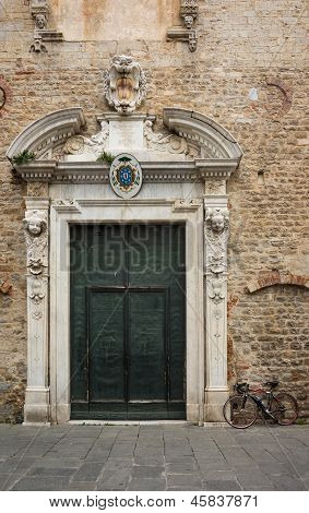 Cathedral portal in Albenga, Liguria, Italy