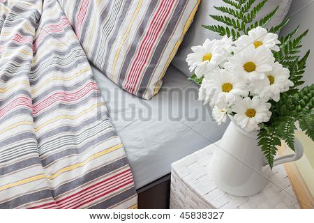 Bright Bedroom Decorated With White Flowers