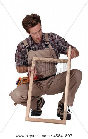 Furniture maker constructing wooden frame