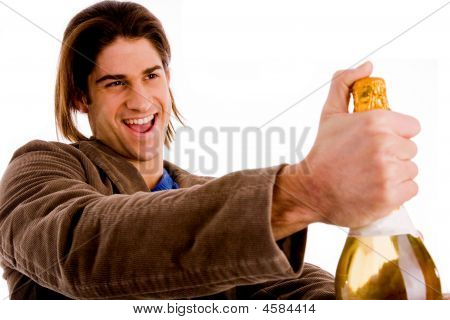 Portrait Of Man Holding Champagne Bottle