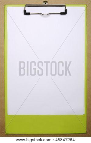 Clipboard On Cardboard Background