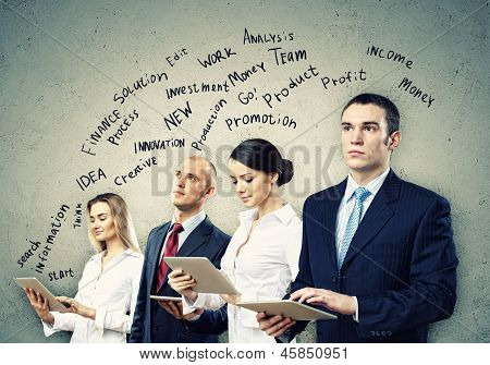 Image of four young businesspeople. Teamwork concept poster