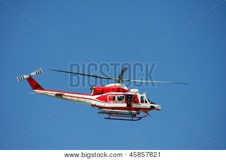 Patrol Helicopter Of Firefighters In Blue Sky Over A Fire 8