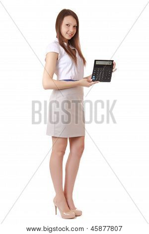 Girl 16 years old shows digits on calculator display. Portrait of a girl full-length auburn hair a gray skirt shirt with short sleeves. The girl smiles. The isolated image on a white background vertical orientation. poster