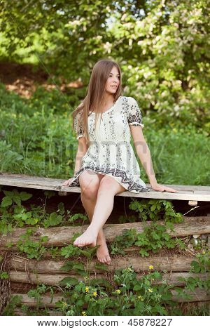 Beautiful Girl Sits On The Boards
