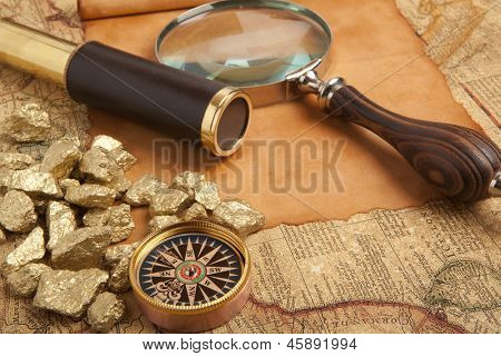 Gold nuggets and vintage brass telescope on antique map poster