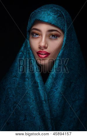Portrait of a beautiful woman in paranja