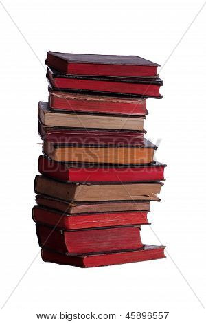Stack Of Very Old Books With Red Pages