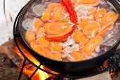 Cooking Chorba soup in cauldron on fire poster