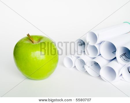 Green Apple And Sheet Of Paper On White Background