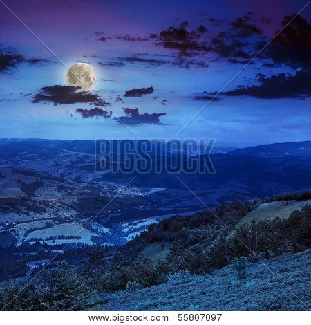 Light  Beam Falls On Hillside With Autumn Forest In Mountain At Night