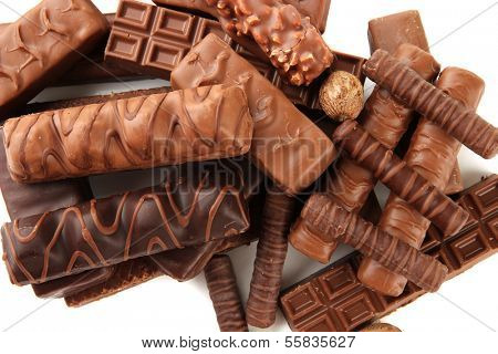 Delicious chocolate bars with nuts close up