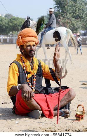Sadhu,holy man perform at annual camel fair,Pushkar,India