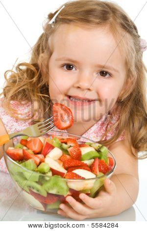 Happy Little Girl With A Large Bowl Of Fruit Salad