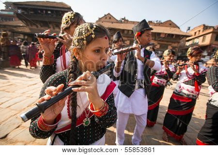 BHAKTAPUR, NEPAL - DEC 20: Unidentified musicians during Birthday celebration head of family - 77 years 7 months 7 days 7 hours old, like rebirth according to Newar, Dec 20, 2013 in Bhaktapur, Nepal.