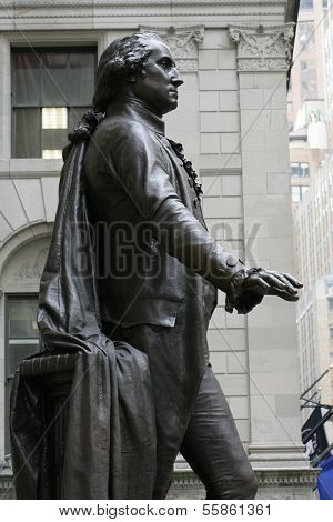 NEW YORK - DEC 19: A profile view of a statue of George Washington is shown in front of Federal Hall on Dec  19, 2013 in New York City.
