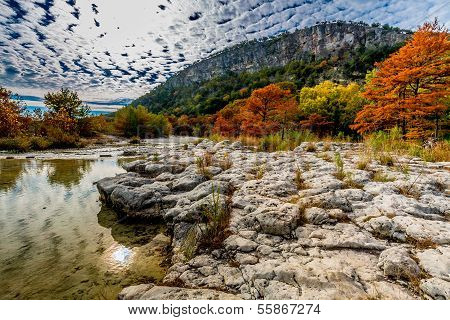 Bright Fall Foliage Lining the Rocky River Bed of the Frio River, Texas