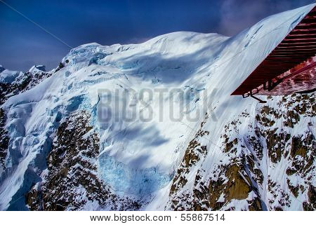 Blue Ice Glacier and Snow-pack on Top of Craggy Mountain Peaks in Alaska