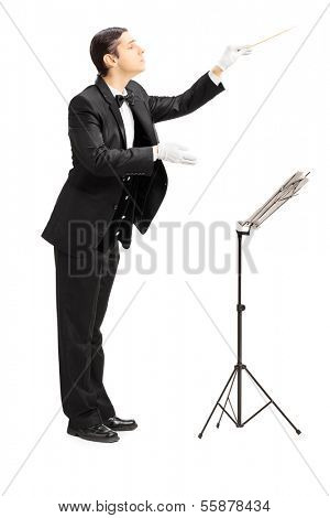 Full length portrait of a male orchestra conductor directing with stick isolated against white background poster