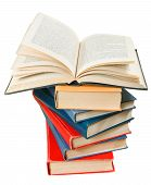 open book on top of stack of books isolated on white background poster