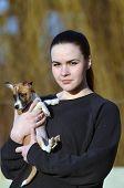 Teen girl with small dog.Near Kiev,Ukraine poster