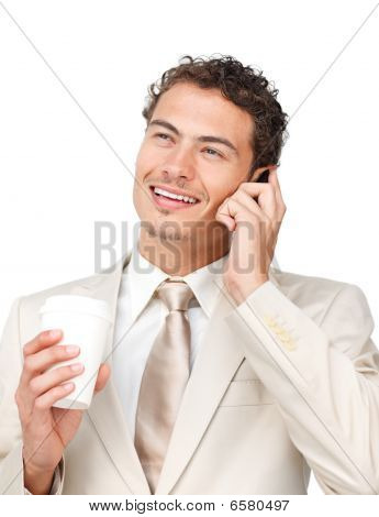 Young Businessman On Phone While Drinking A Coffee